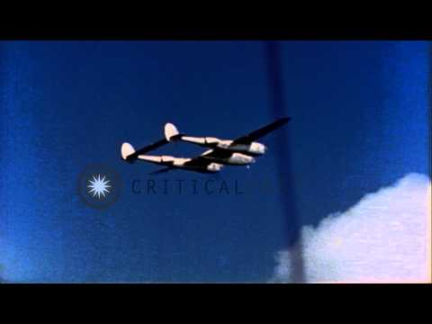 Aguiguan Island south of Tinian. P-38 in flight. Fleet at Ulithi anchorage in Car...HD Stock Footage