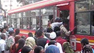 Getting on a bus in India