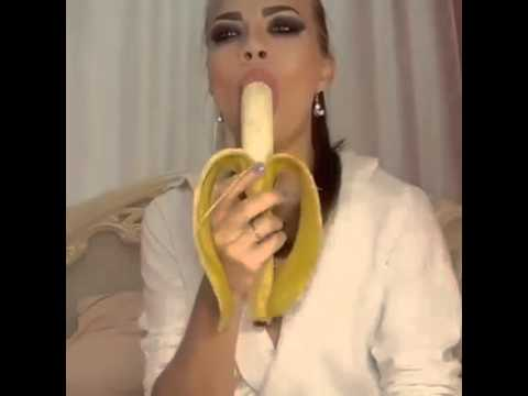 Deep throating a banana. Sexy women deep throats vagina