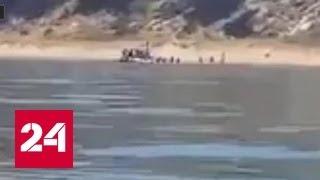 Высадка беженцев на побережье Сицилии похожа на операцию спецназа