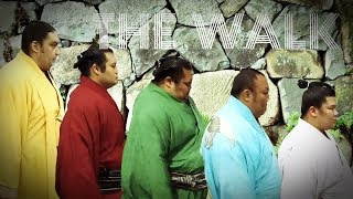 SUMO Wrestlers walk as if they were top fashion models. The actuall...