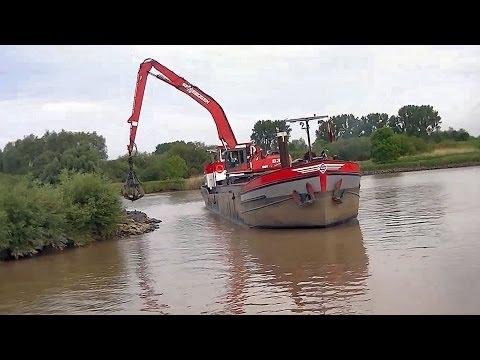 "Baggerschiff ""Neptunus"" mit Sennebogen 835 / Dredger ""Neptunus"" with excavator Sennebogen 835"