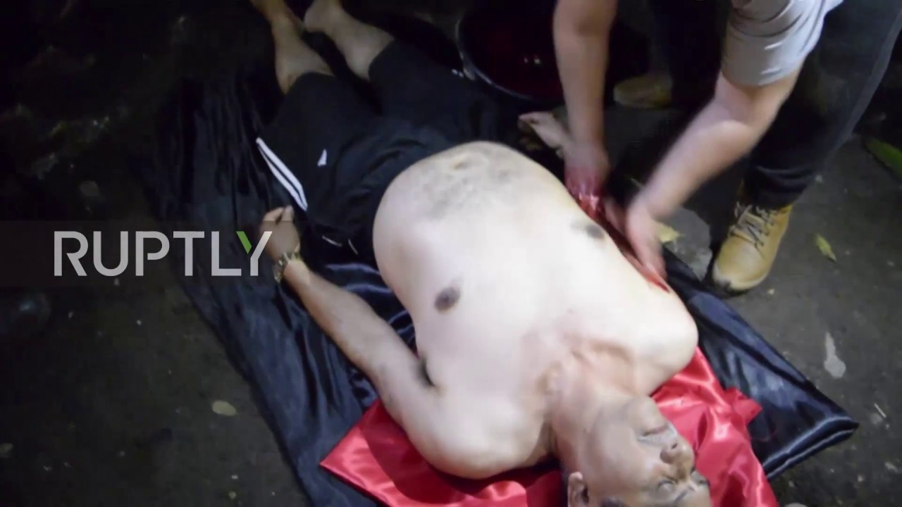 Worshippers summon the Devil in Blood-soaked satanic 'Black Mass' ritual