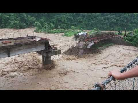 हेर्दा हेर्दै खोलाले पुल बगायो। dangerous flood in nepal- by online jamana