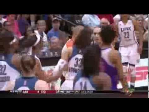WNBA female player Diana Taurasi kisses Seimone Augustus while playing basketball