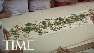 50 Pizza Makers In Italy Have Made The Longest Fried Pizza In The World | TIME