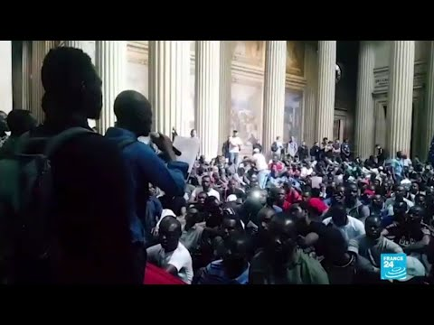 Hundreds of migrants occupy Paris Pantheon in 'Black Vests' protest