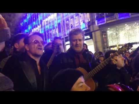 Bono U-2 sings in Dublin at Grafton Street on Christmas Eve 2013
