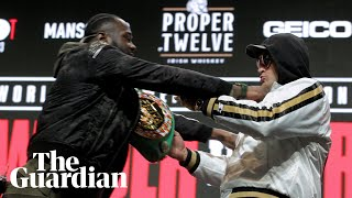 Deontay Wilder and Tyson Fury shove and taunt each other before rematch