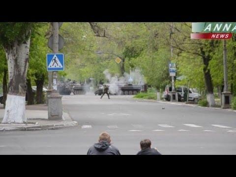 Heavy gunfire heard in eastern Ukraine as Putin visits Crimea