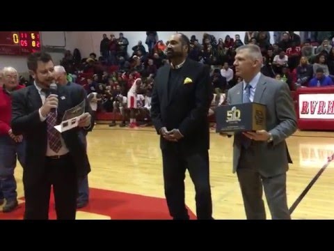 Franco Harris presents Rancocas Valley Regional High School with Golden Football