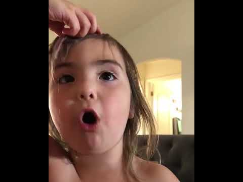 Little Girl Cuts her Hair - 976836