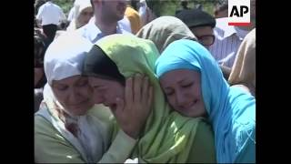 Mass funeral for 94 Bosnian Muslims killed by Serb forces 15 years ago