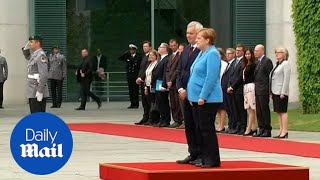 Angela Merkel seen shaking for third time as she greets Finnish PM