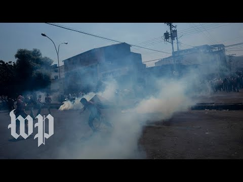 Clashes erupt on Venezuela border as convoys from Colombia attempt to enter the country