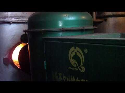 The biomass burner connect with the hot water boiler