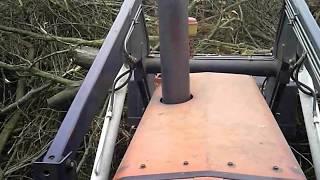 Pushing brush with a Massey 1135