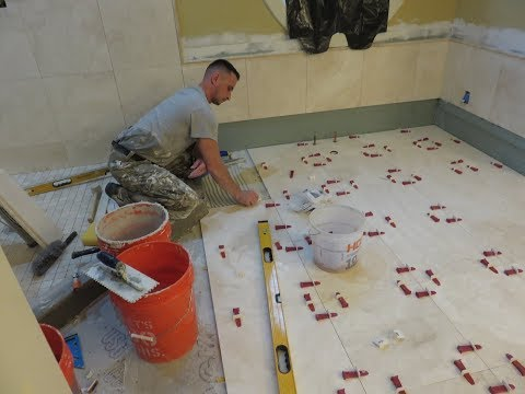 """1"" Installing 18x18 Travertin stone tiles on bathroom floor with T-Lock leveling system"