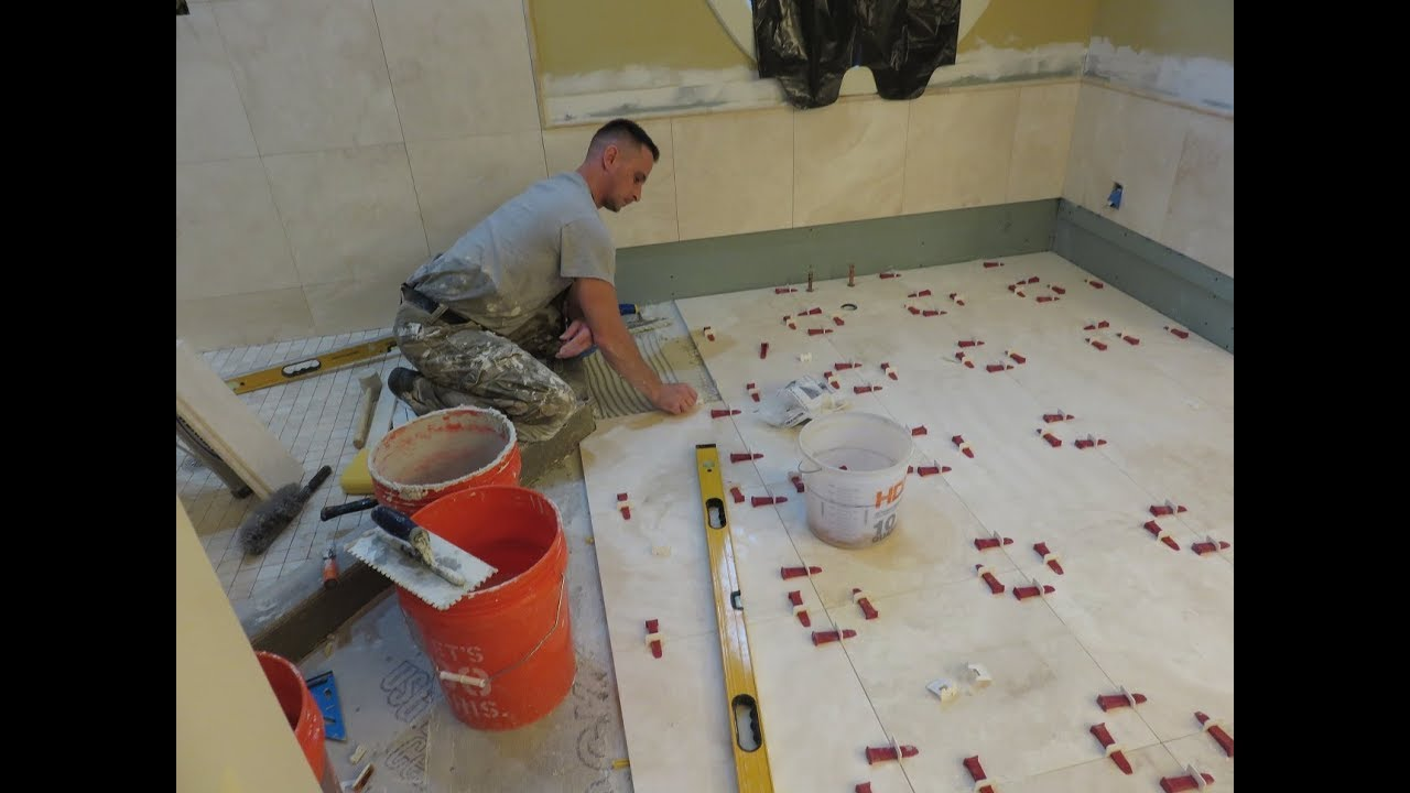 1 installing 18x18 travertin stone tiles on bathroom - Installing a lock on a bedroom door ...