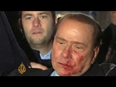 Berlusconi Attacked At Milan Rally