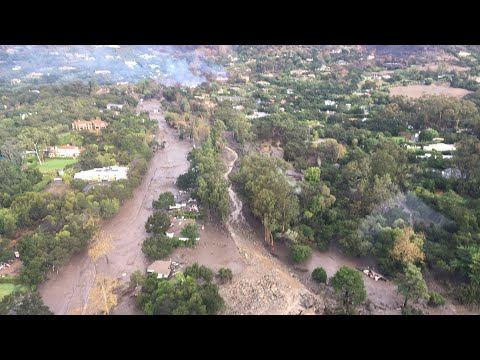 Mud and boulders slide down California hills - aerial video