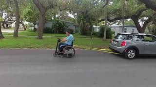 Wheelchair towing a car!  Must see!