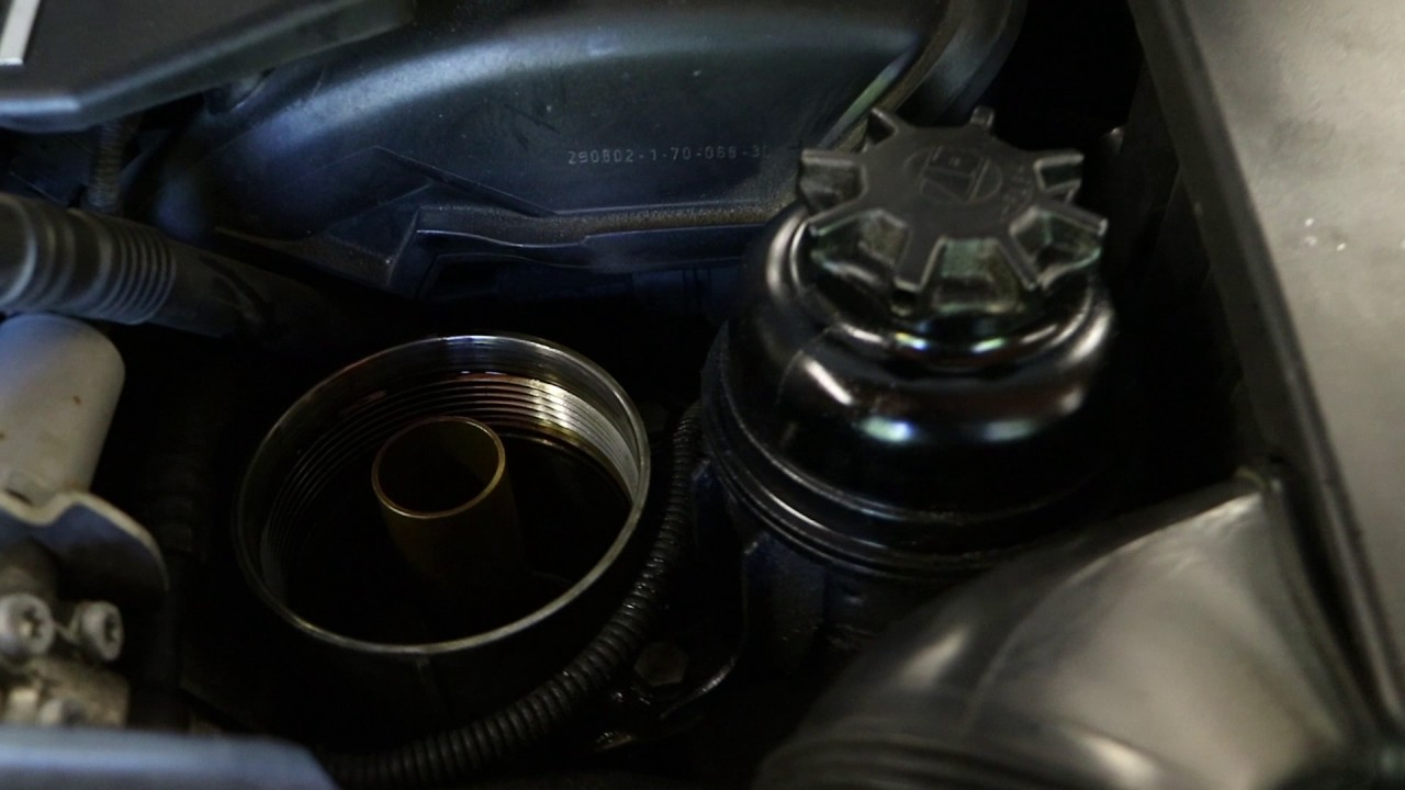 how to change oil filter housing gasket on e46