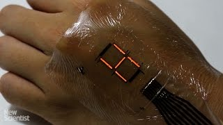 super thin digital display turns your skin into a screen