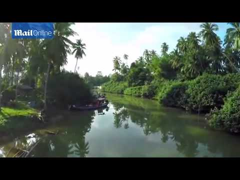 Idyllic islands, stunning waterfalls and giant Buddha statues: Filmmaker uses drone to capture Thai
