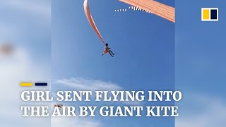 Girl in Taiwan sent flying into the air by giant kite