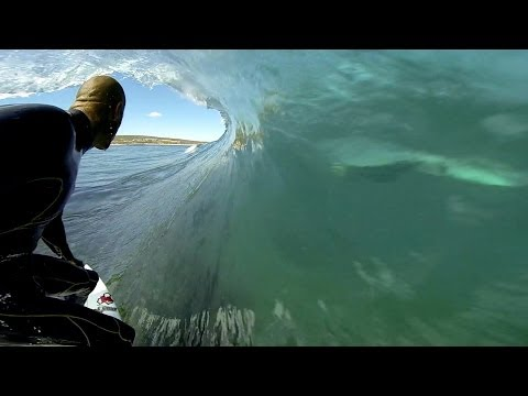 GoPro: Kelly Slater and Dolphins Surf The Box