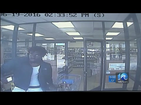 Surveillance video shows suspect leaving store with cart full of stolen liquor
