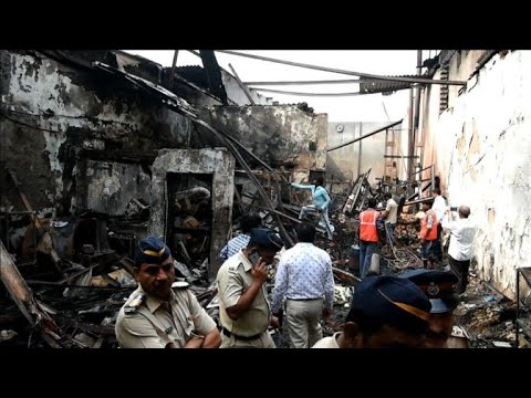 Fire and collapse in Mumbai shop kills 12