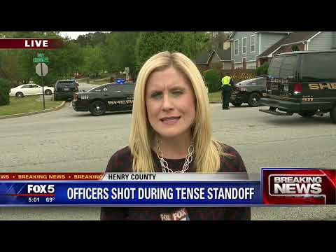 Henry County Police officers shot; hostage situation