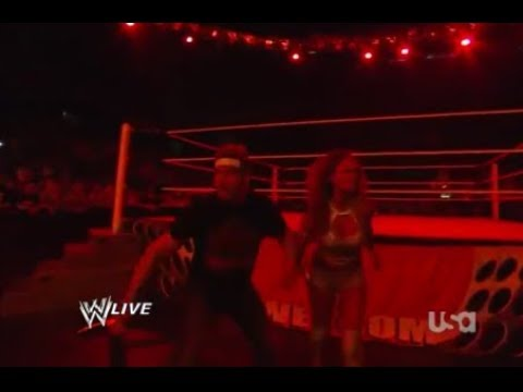 Kane chases Eve and Zack Ryder