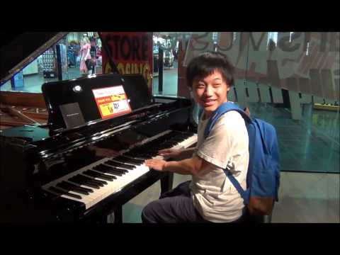 Lucas - Playing the Grand Piano worth $82,000