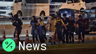 Thai Police Rush People Out of Mall Where Gunman Killed 27 and Injured 57