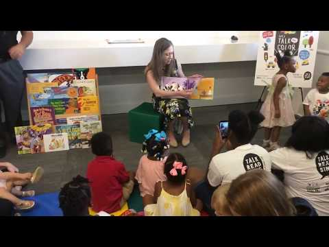 Chelsea Clinton reads to children at the Children's Hospital Conference Center