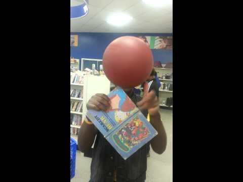 Stephon Davis spinning a basketball on a book