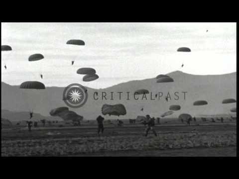187th Airborne Regimental Combat Team practice parachute drop in Korea. HD Stock Footage