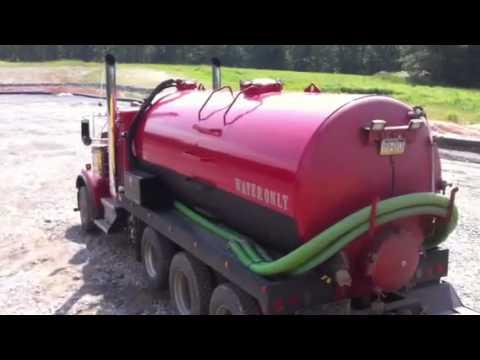 Vacuum truck loading water from frac tank