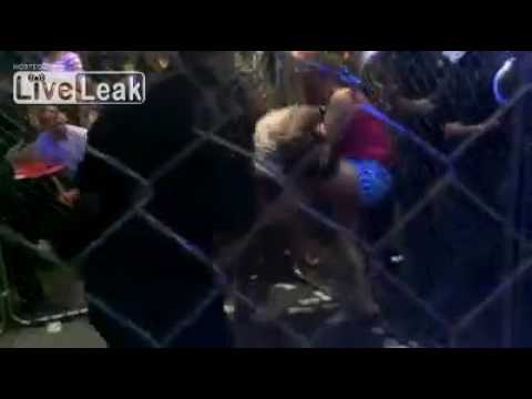 Reina fights african American woman in cage at underground fight club