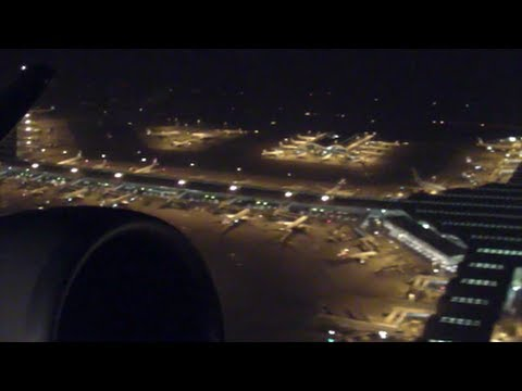 Takeoff at night from Hong Kong Airport Chek Lap Kok. Boeing 777 Cathay Pacific