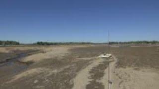 Michigan lake left nearly empty after dam fails