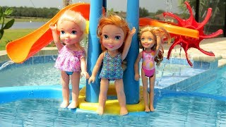 WATER PARK ! Elsa & Anna toddlers empty the Pool ? Water Fun - Swim - Pool Party - Splash - Sand thumbnail
