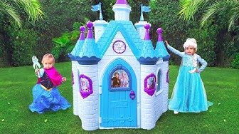 Maya and Mary playing with toy castle of the princess