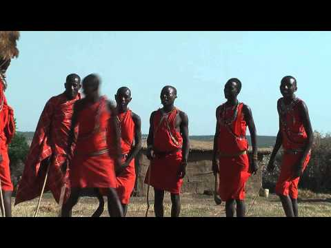 Masai people dance in their traditional Manyatta in Kenya