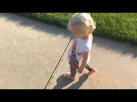 Toddler tries to get rid of her shadow and fails miserably