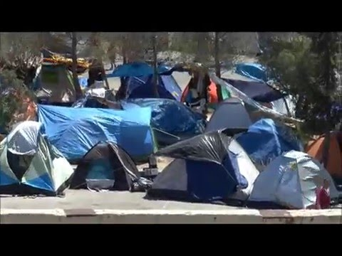Refugees and Illegal Immigrants in a tent camp at the Port of Piraeus, Greece