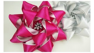 Hello everyone, again new video. This ribbon flower tutorial is sup...